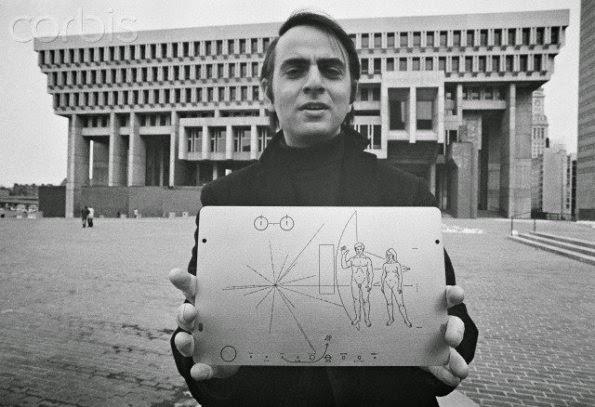 Carl Sagan holding the Pioneer Plaque